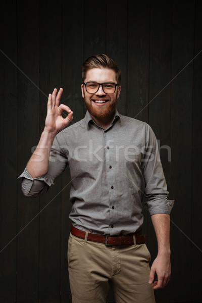 幸せ 男 を見る オーケー 肖像 笑みを浮かべて ストックフォト © deandrobot