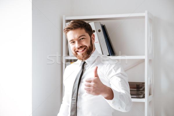Boldog fiatal üzletember remek kézmozdulat kép Stock fotó © deandrobot