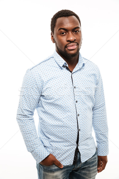 Handsome young african man dressed in shirt Stock photo © deandrobot