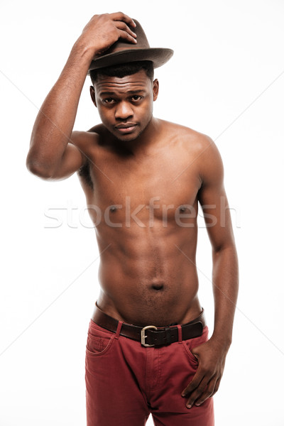 Handsome young african sportsman wearing hat Stock photo © deandrobot
