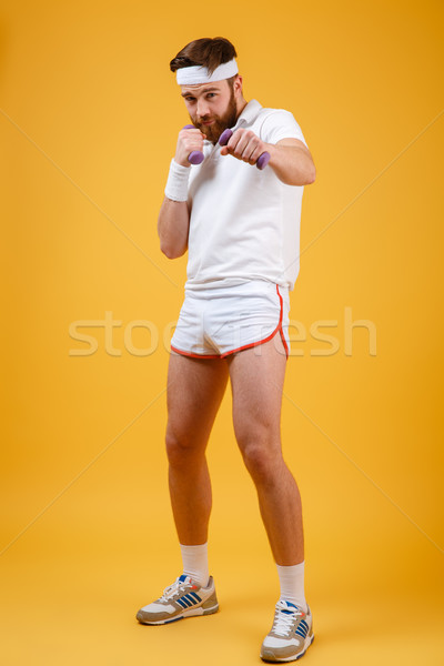 Vertical image of sportsman beats at camera Stock photo © deandrobot