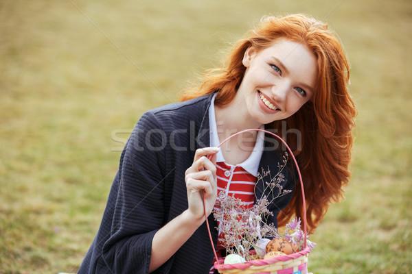 Boldog csinos lány tart piknikkosár húsvéti tojások Stock fotó © deandrobot