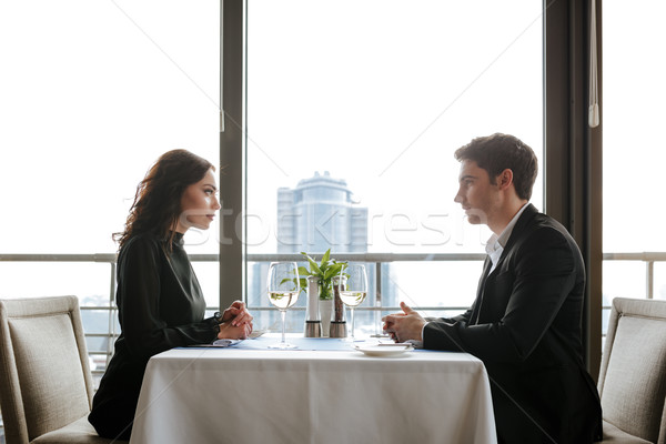 Side view of young couple in restaurant Stock photo © deandrobot