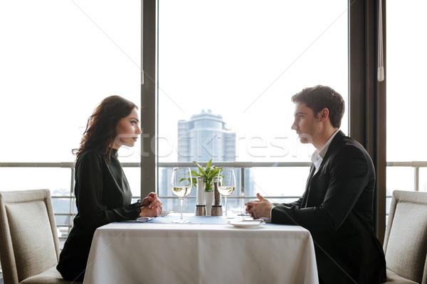 ストックフォト: 側面図 · レストラン · 座って · 表 · ビジネス
