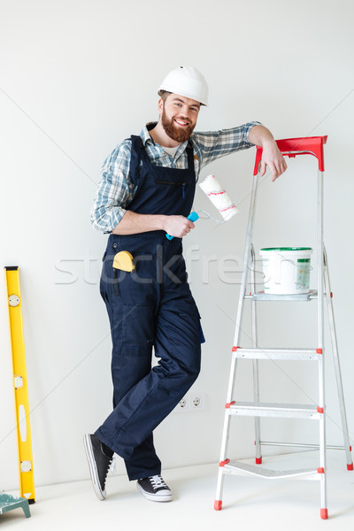 Full-length shot of builder with roll and paint near ladder Stock photo © deandrobot
