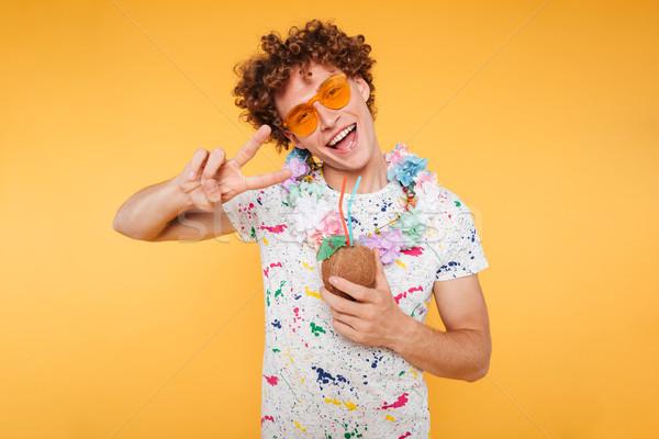 幸せ 魅力的な 男 サングラス ココナッツ ストックフォト © deandrobot