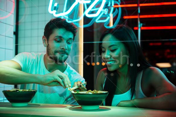 Több nemzetiségű mosolyog szerető pár ül kávézó Stock fotó © deandrobot