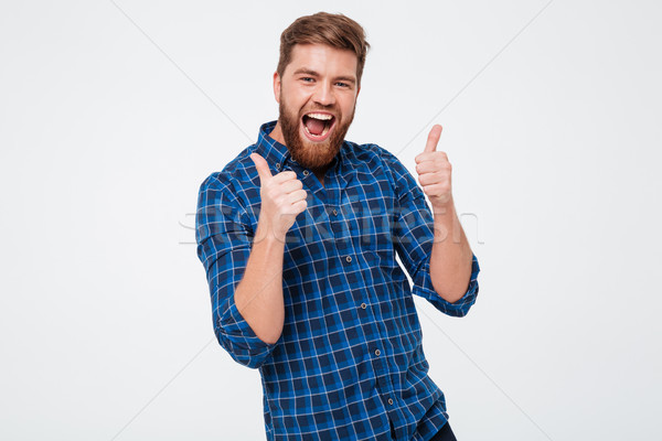 Screaming bearded man in checkered shirt showing thumbs up Stock photo © deandrobot