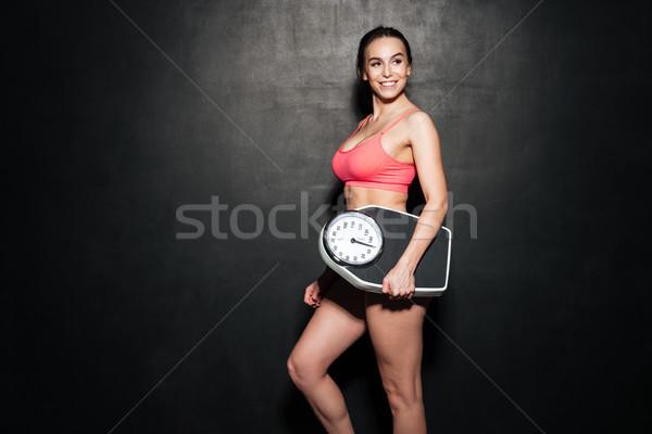 Szczęśliwy sportsmenka skali szary obraz Zdjęcia stock © deandrobot