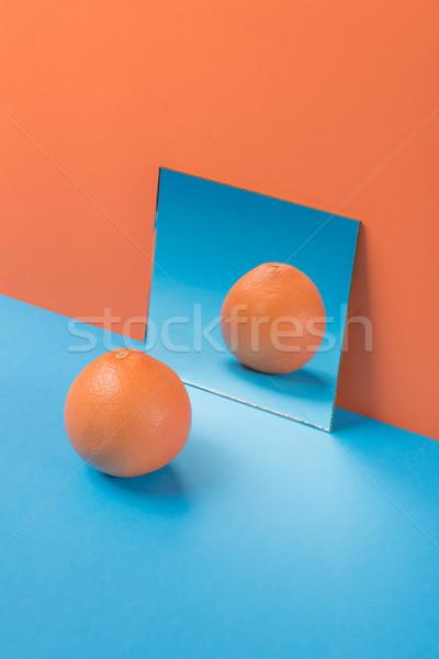 Grapefruit Blauw tabel geïsoleerd oranje afbeelding Stockfoto © deandrobot