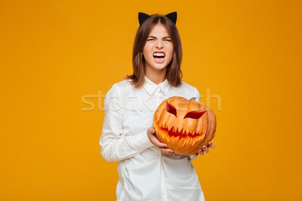 érzelmes fiatal nő őrült macska halloween jelmez Stock fotó © deandrobot
