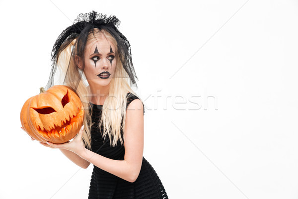 Dreadful blonde woman dressed in black widow costume Stock photo © deandrobot