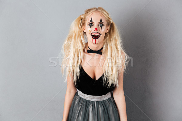 Portrait of a crazy laughing blond woman in halloween Stock photo © deandrobot