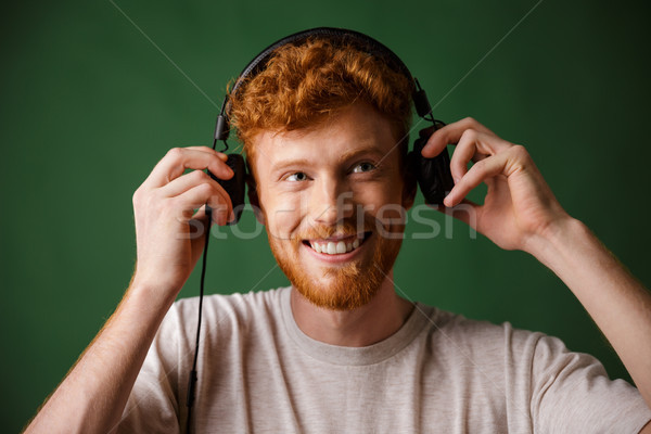 Stock photo: The teenager is enjoying listening to music,