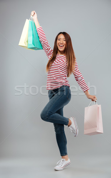 Image heureux asian femme chandail Photo stock © deandrobot