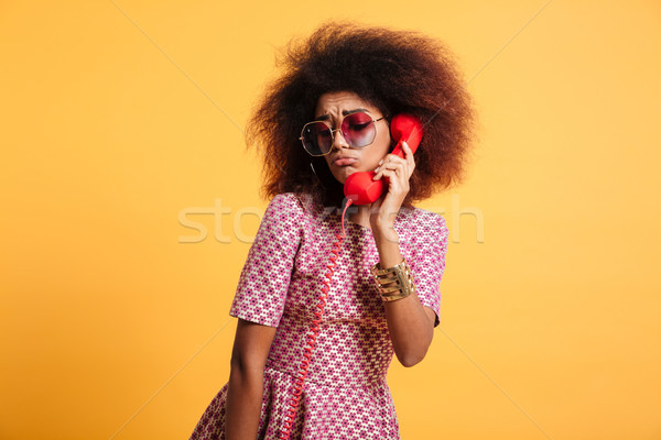 Close-up photo of upset retro girl with afro hairstyle posing wi Stock photo © deandrobot