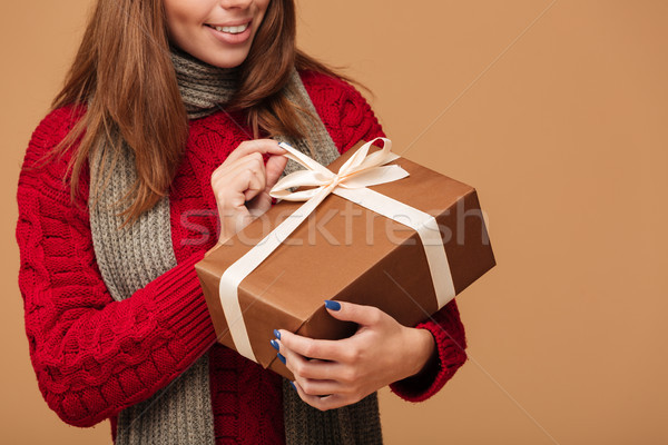 Cropped photo of young brunette woman in winter clothes holding  Stock photo © deandrobot