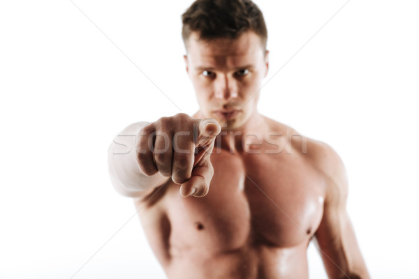 Close-up photo of strong sports man with short haircut pointing  Stock photo © deandrobot