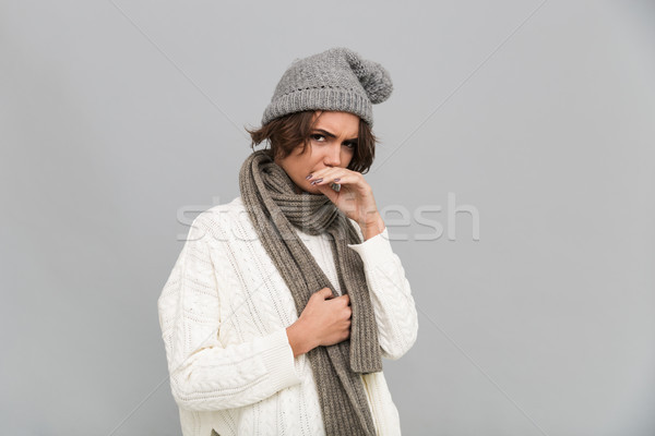 Portrait of an unsatisfied frozen girl in scarf and hat Stock photo © deandrobot