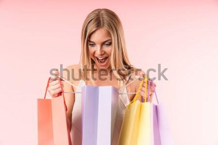 Afbeelding tevreden blonde vrouw naar colli roze Stockfoto © deandrobot