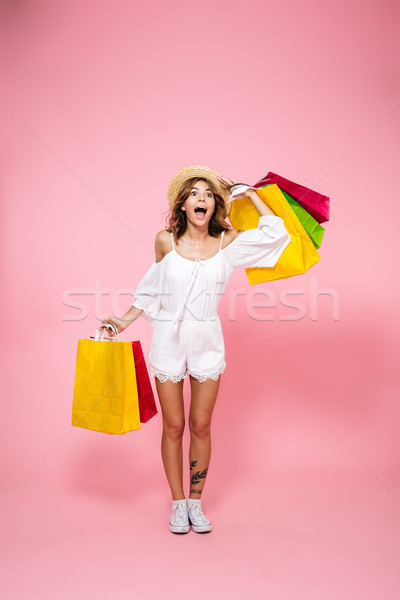 Full length portrait of an excited satisfied girl Stock photo © deandrobot