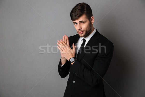 Close-up photo of handsome young man in black suit clap in hands Stock photo © deandrobot