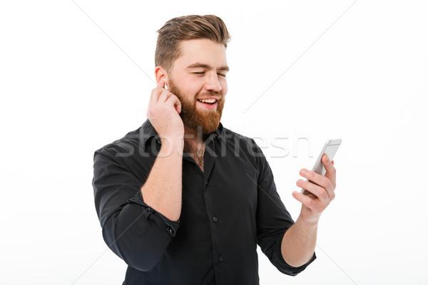 бородатый человека рубашку прослушивании музыку Сток-фото © deandrobot