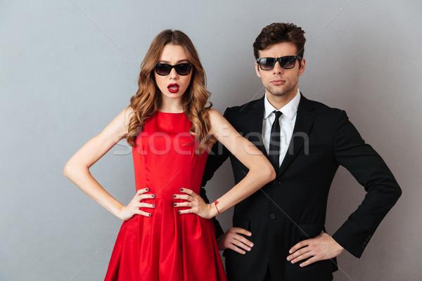 Portré gyönyörű pár hivatalos visel napszemüveg Stock fotó © deandrobot