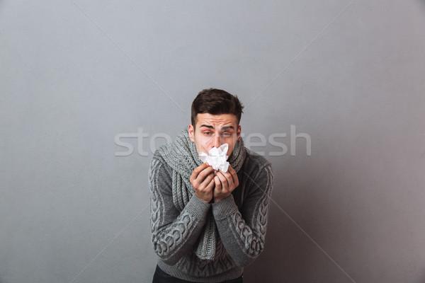 Niezadowolony choroba człowiek ciepły szalik Zdjęcia stock © deandrobot