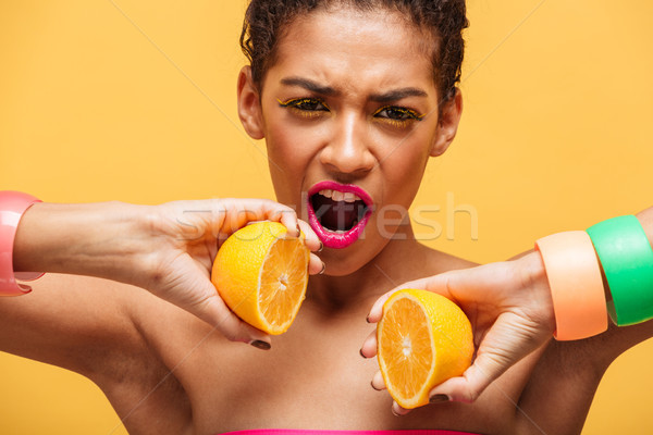 Conceptual photo of amazing afro american woman putting two part Stock photo © deandrobot