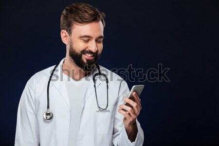Сток-фото: портрет · счастливым · мужской · доктор · равномерный · стетоскоп · мобильного · телефона