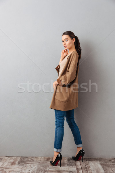 Side view full length of a pretty young asian woman Stock photo © deandrobot