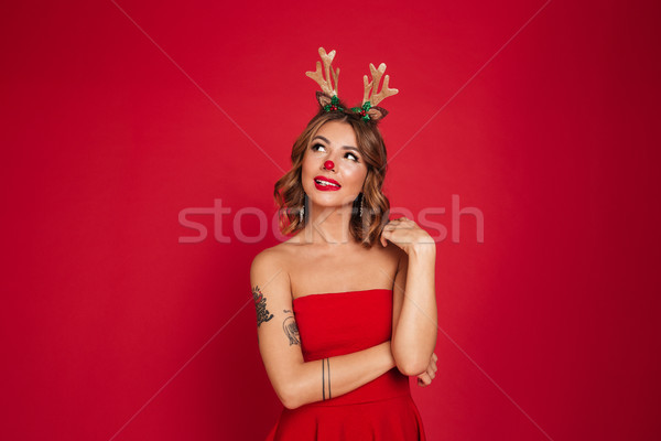 Portrait of a lovely toughtful girl wearing christmas deer costume Stock photo © deandrobot