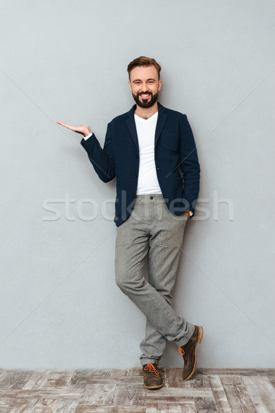 Full length image of happy bearded man in business clothes Stock photo © deandrobot