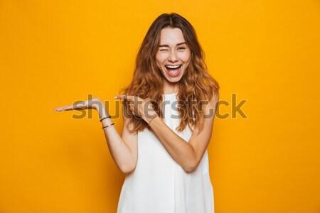 Heyecanlı genç güzel kadın cep telefonu Stok fotoğraf © deandrobot