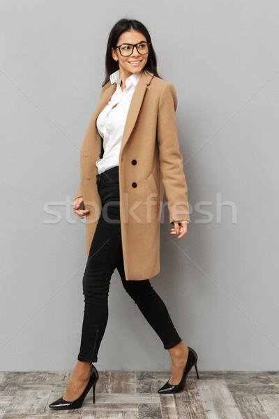 Imagine femeie frumoasa ochelari bej Imagine de stoc © deandrobot