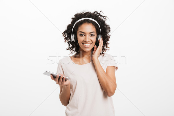 Stock photo: Fascinating american woman with curly hairstyle and big smile li
