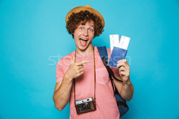 фото парень вьющиеся волосы рюкзак Сток-фото © deandrobot