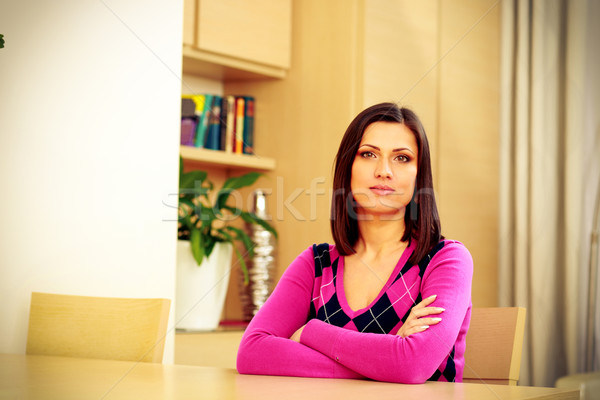 задумчивый женщину сидят таблице девушки Сток-фото © deandrobot