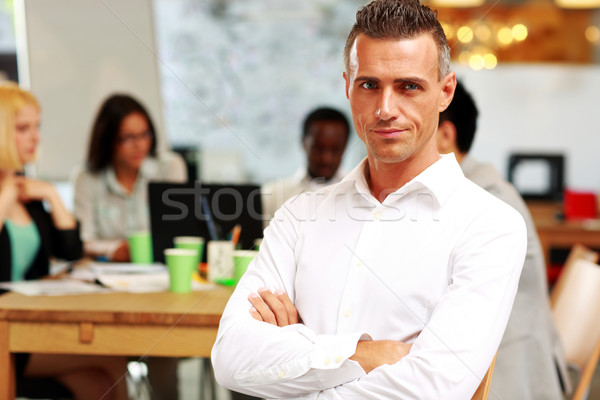 портрет бизнесмен оружия сложенный сидят Сток-фото © deandrobot
