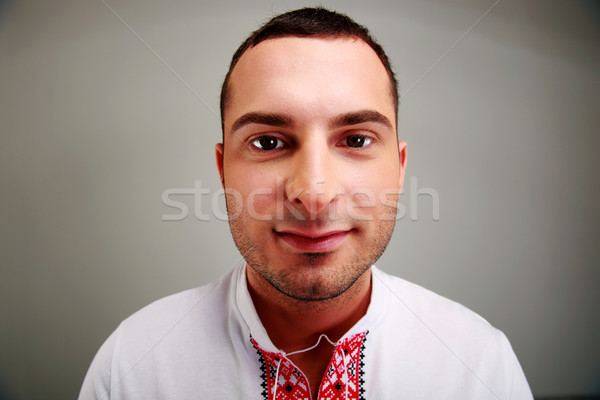 Closeup portrait of man in the Ukrainian national clothes on gray background Stock photo © deandrobot