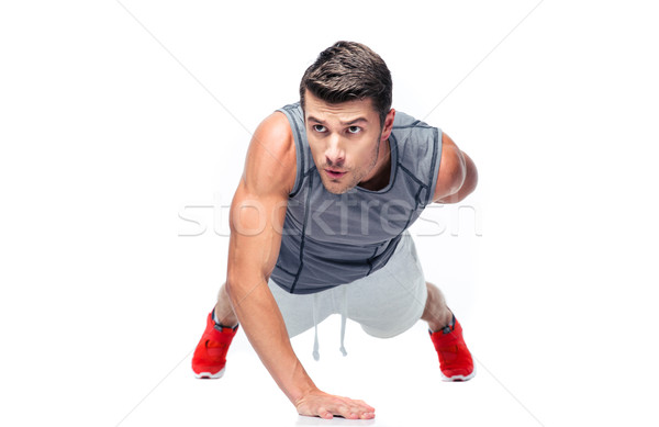 Fitness handsome man doing push ups Stock photo © deandrobot