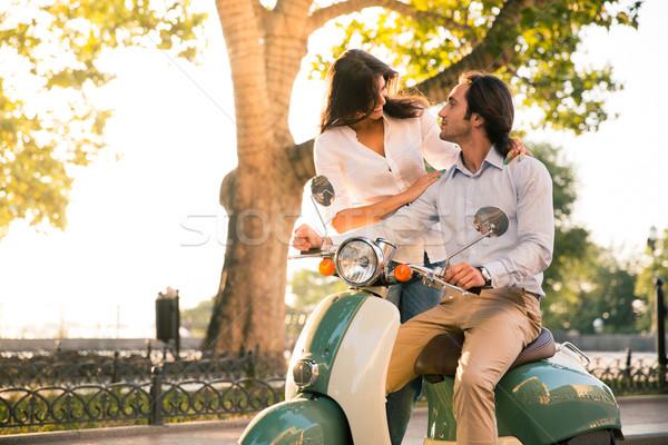 Boldog európai pár flörtöl moped város Stock fotó © deandrobot
