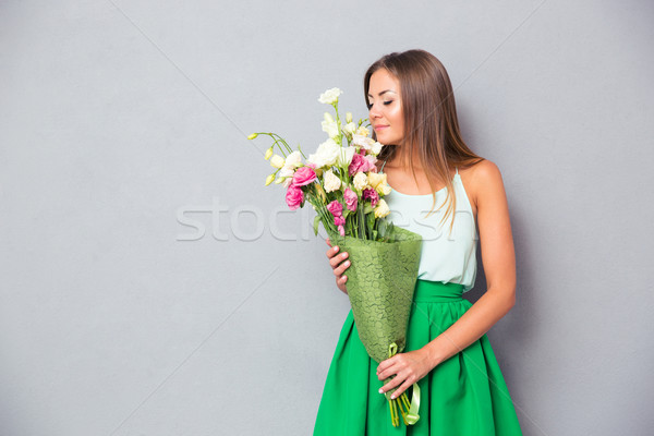 Portrait of a beautiful woman smelling Stock photo © deandrobot