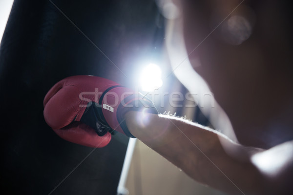 Female hand in boxing glove Stock photo © deandrobot