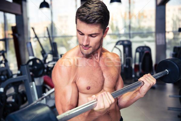 Człowiek sztanga siłowni portret muskularny dziewczyna Zdjęcia stock © deandrobot