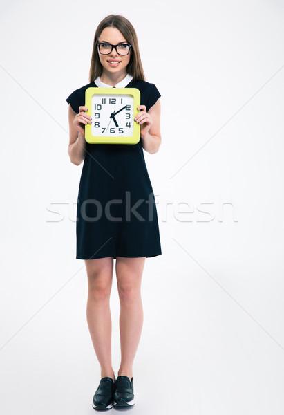 Smiling female student holding big clock Stock photo © deandrobot