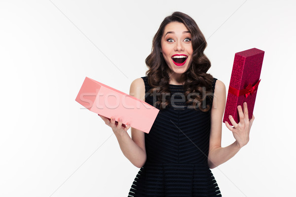 Happy amazed  retro styled woman with curly hair opened present  Stock photo © deandrobot