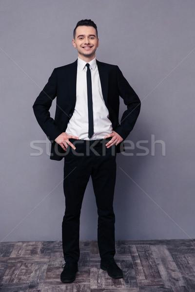 портрет улыбаясь бизнесмен Постоянный серый Сток-фото © deandrobot