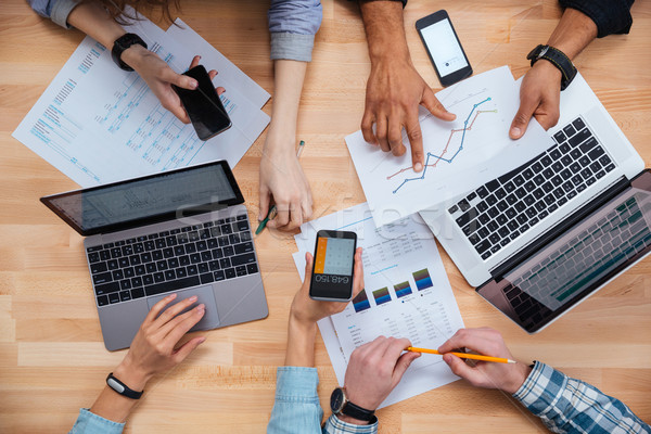 Group of business people working for a financial report  Stock photo © deandrobot